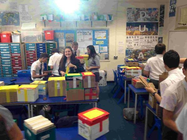 Year Nine students at St Peter's School in Bournemouth pack up textbooks to be sent to a school in South Africa