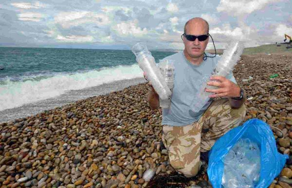 Fears for ocean life after hundreds of plastic cups found washed up on Dorset beach