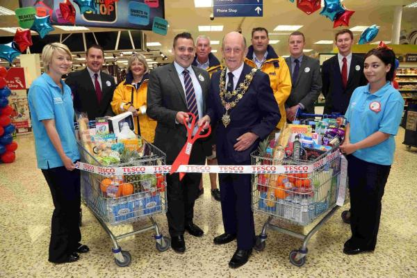 WE'RE OPEN: Poole mayor Cllr Peter Adams cuts the ribbon
