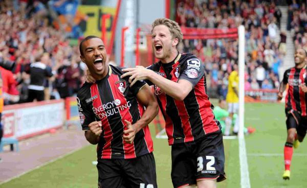 TOP OF THE LEAGUE: Junior Stanislas and Eunan O'Kane celebrate Saturday's winner.