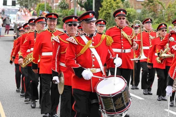 MARCH ON: Scarlet jacketed bandsmen on Alder Hills