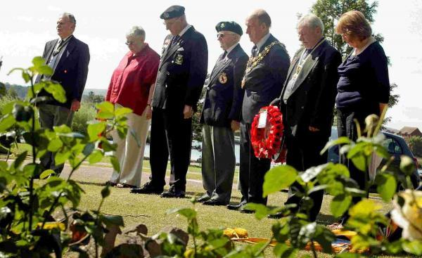 A wreath laying at the Burma Star Memorial Rose Garden in Poole Park