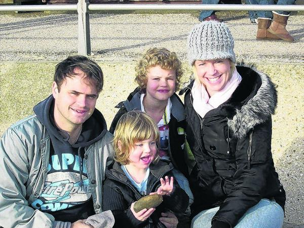VICTORY: Michelle and Stuart Amey  with sons  George and Charlie