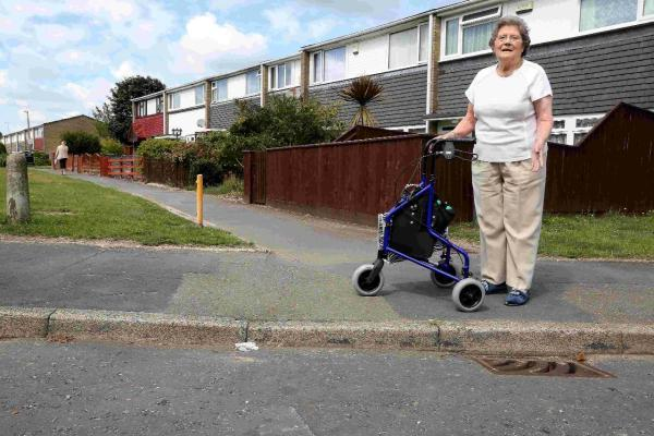 DANGEROUS: Pensioner Andrea Carrington with the raised curb where she has fallen repeatedly