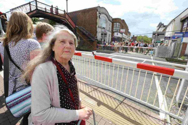 FEARFUL: Letitia Lawrence beside the railway crossing in Poole town centre, where she has been struck twice by the barriers