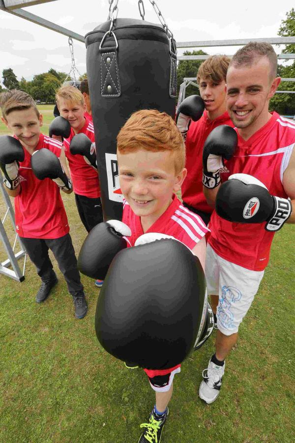 HANDS ON: Owen Perdrisat, 10, with other members of the Wessex Amateur Boxing Club