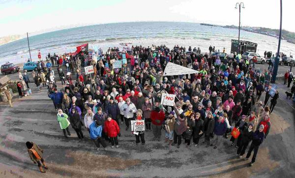 NOT HERE: People gather on Swanage seafront to protest