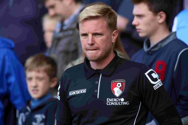 MUCH TO PONDER: Cherries boss Eddie Howe looks on at Ewood Park yesterday