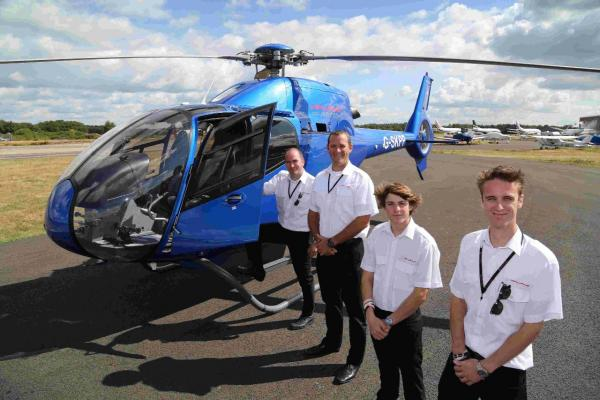 INTERNATIONAL: Ollie Pennington, right, managing director of Airways Aviation and some of his team, from left, chief helicopter flying instructor Jim Hammett, operations manager Nick Bird and operations assistant Matt Joynes