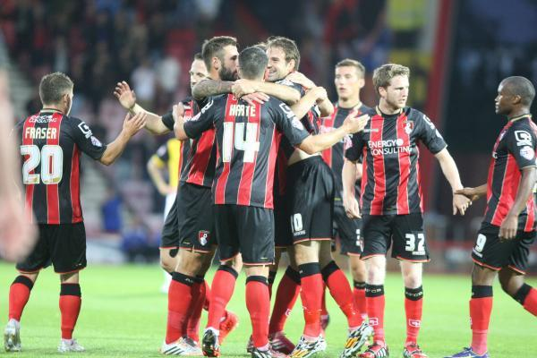 STRIKE ONE: Cherries players celebrate Dan Gosling's opener