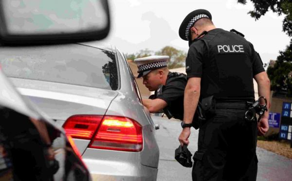 Sgt Stuart Pitman of Dorset Police talking to a motorist who had been caught driving at 86mph on Dorset Way