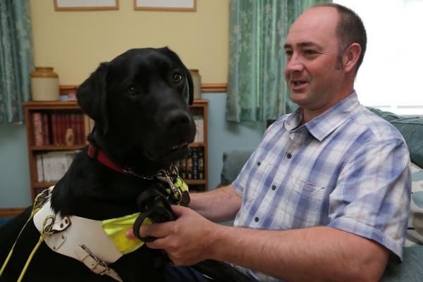Pete Bungay with his guide dog Thomas