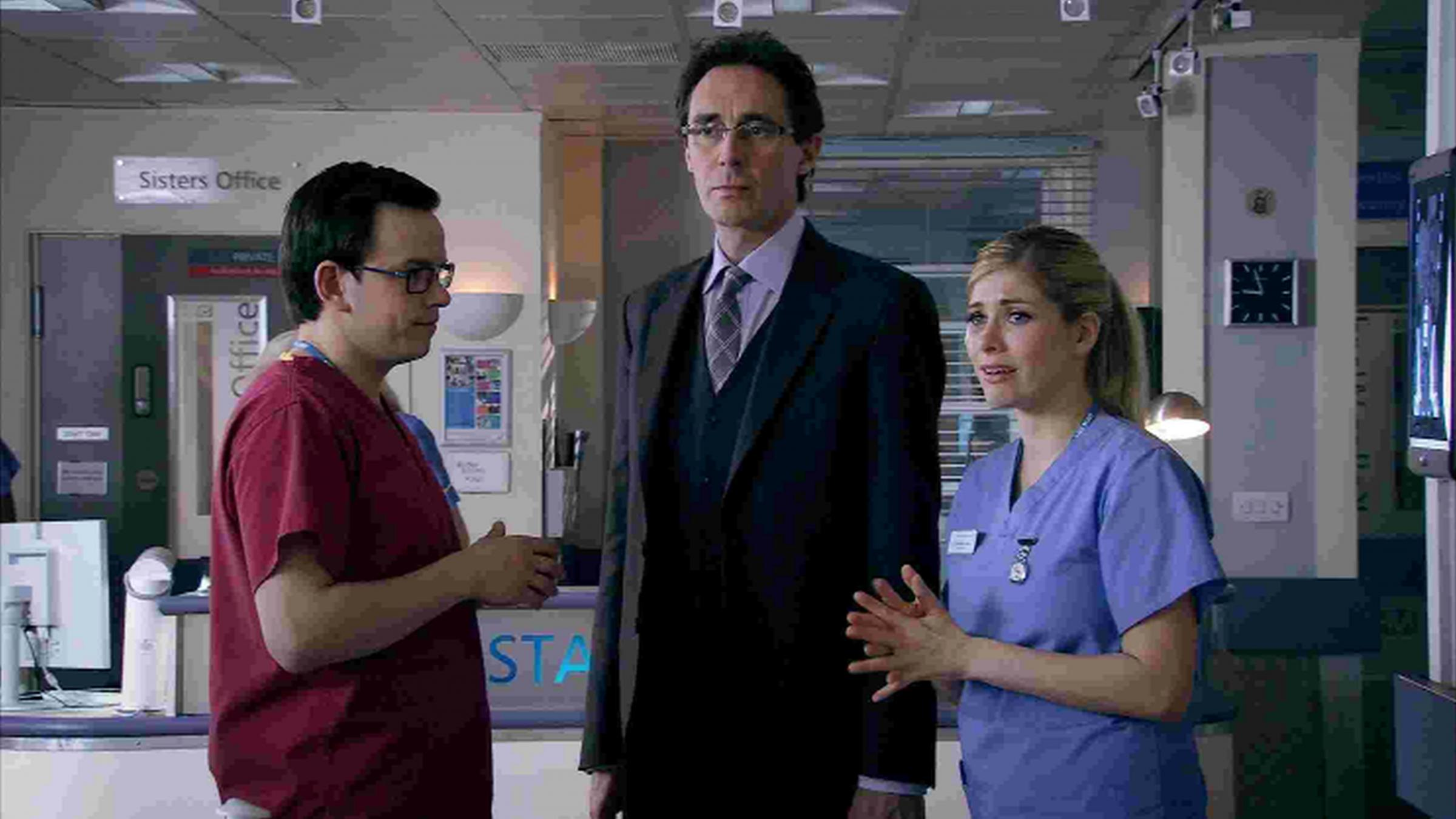 Actor Guy Henry, centre, in Holby City