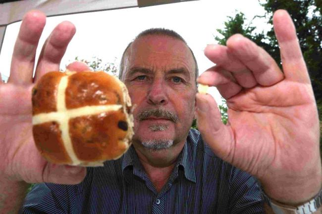 'DISGUSTED': Alan Roberts, who alleges he has found a tooth in a hot cross bun from Aldi