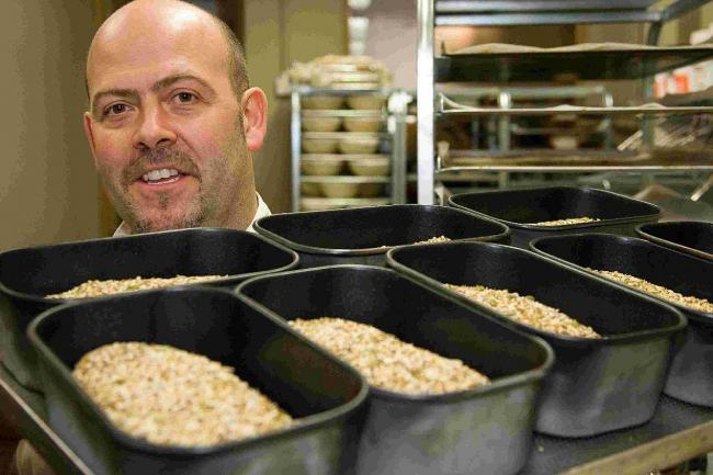 AIMING HIGH: Mark Bennett, in action at his bakery