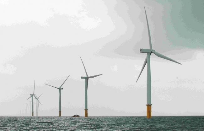 An array of wind turbines at sea