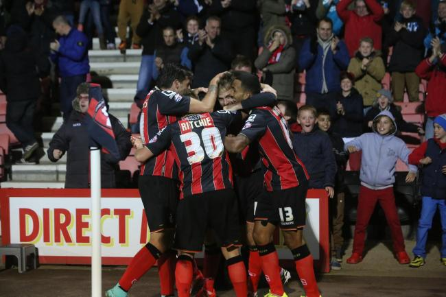 GET IN THERE! AFC Bournemouth striker Brett Pitman is mobbed after scoring.