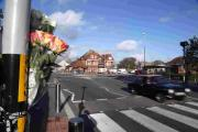 A floral tribute to David Dixon near the scene  of the collision
