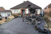 Caravan destroyed and two homes and car damaged in blaze