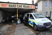 NOTICE: Immigration enforcement officers at the Hot Hand Car Wash at Gloucester Road in Boscombe