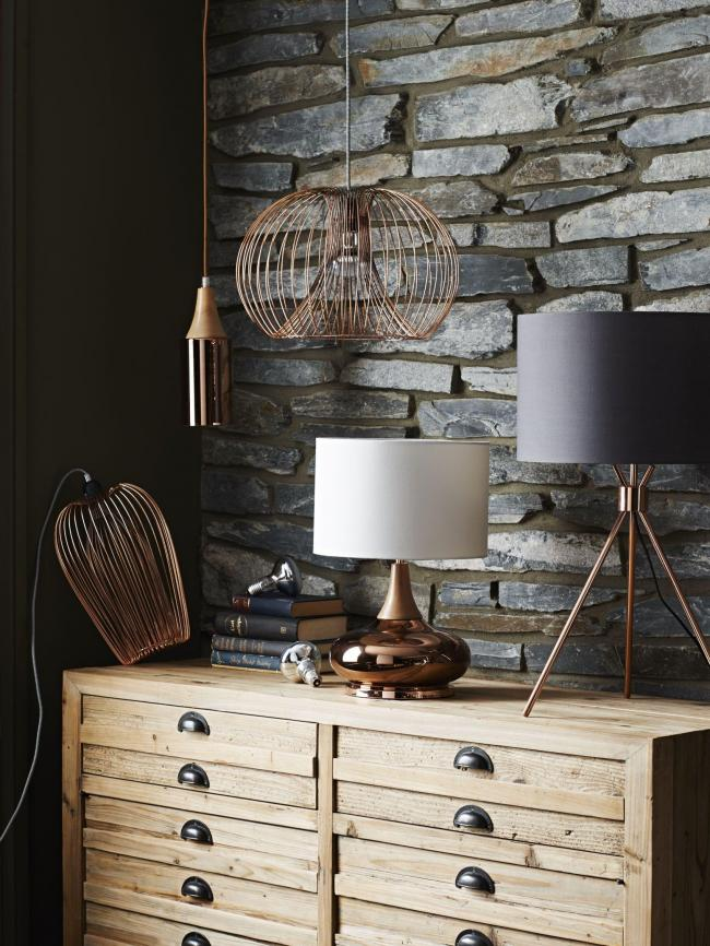 By Sainsbury's copper finish glass and wood lamp, £45; By Sainsbury's copper finish tripod table lamp, £40; By Sainsbury's round copper finish wire pendant, £30; oval copper finish wire pendant, £30, all Sainsbury's (available in larger stores