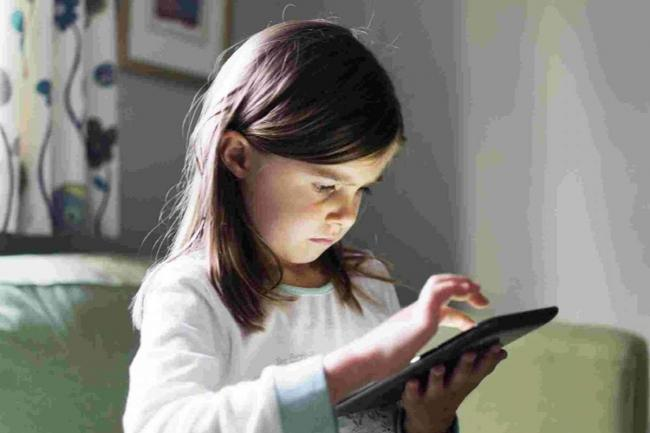 Children moving away from the TV and into the digital world, Ofcom reveals