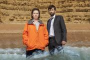 David Tennant and Olivia Coleman. No, we don't know why they're standing in the water.