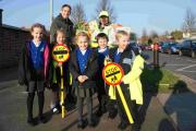 Caoline Bugler, children from the school and head teacher Nigel Helm