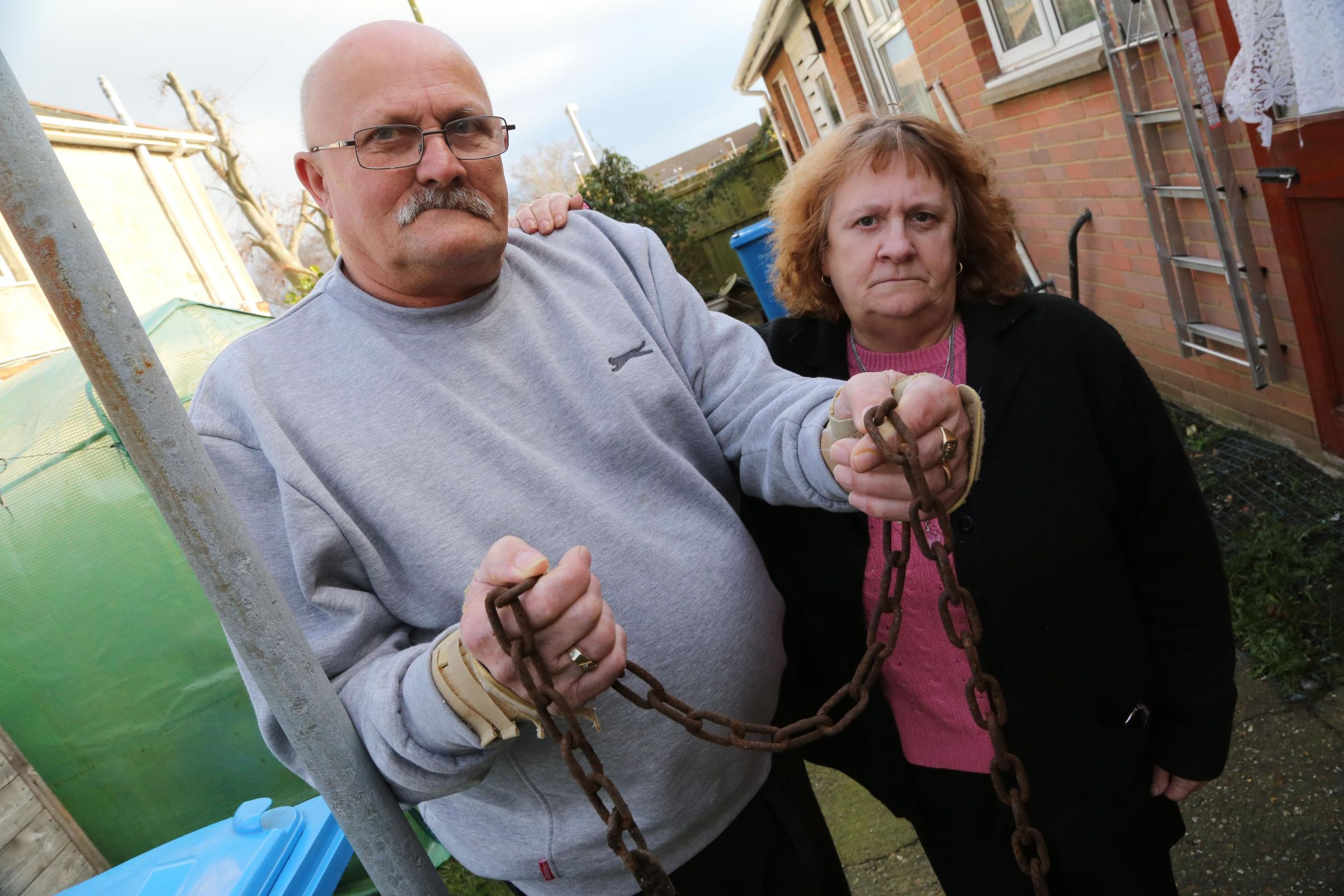 Colin and Linda Pidgley, grandparents of Jade Clark, with the chain that had been used to lock the scooter to a post. Picture: Corin Messer