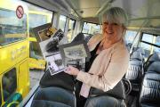 ARCHIVE: Yellow Buses head of marketing Jenni Wilkinson with pictures from their archive
