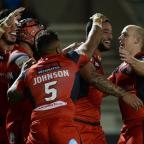 Bournemouth Echo: Weller Hauraki, second right, celebrates after scoring Salford's second try