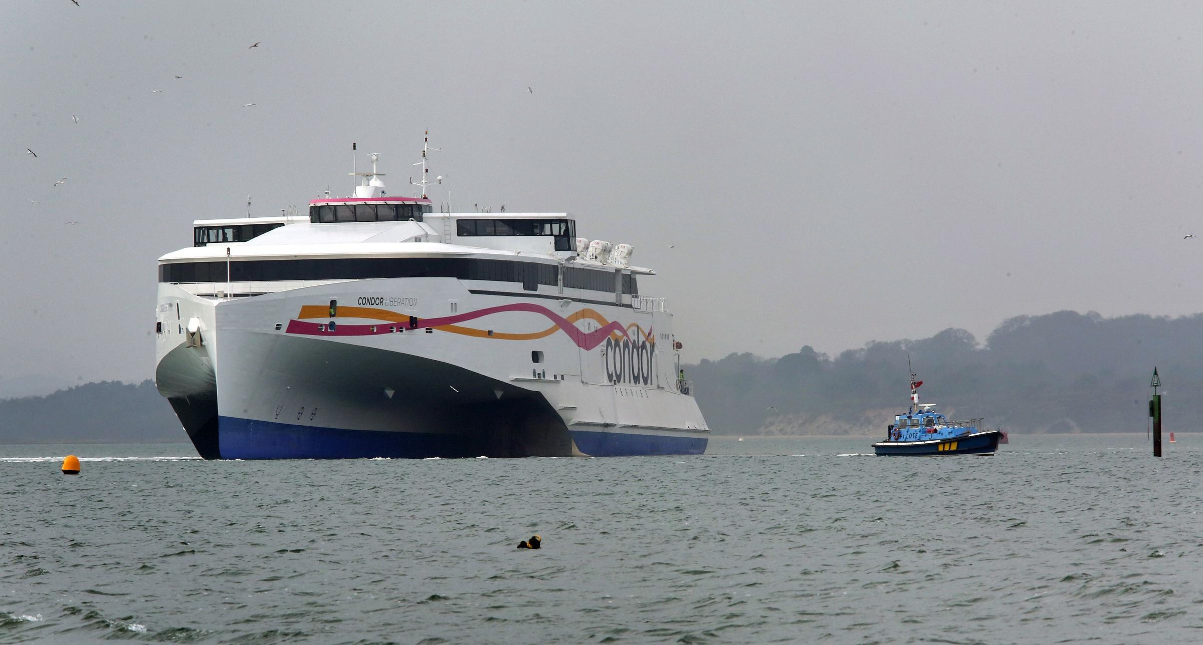 Condor Ferries' new fast ferry Condor Liberation heads out from Poole Port and across the harbour for a trial programme.
