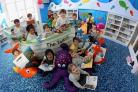 Pupils from St Mark's School in Talbot Village enjoy their new library.
