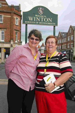 AUSSIES IN TOWN: Gail and Marion standing by the Welcome to Winton' sign in Bournemouth