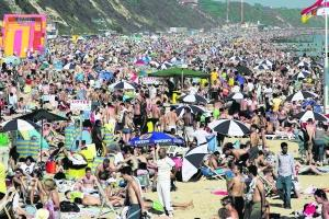 Bournemouth Echo: FULL AND FUN: A packed Bournemouth beach on Sunday afternoon