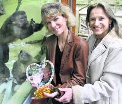 HEART FELT: Ruth Stannard presents the Shining World Compassion Award to Alison Cronin in recognition of the work of Monkey World in rescuing 88 capuchin monkeys from a medical lab in Chile