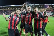 GOING UP: AFC Bournemouth defender Steve Cook (centre)