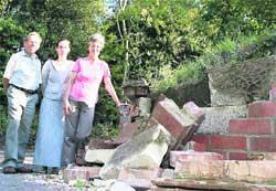 DAMAGE: The Selway family at their Merley home where a bus struck a wall