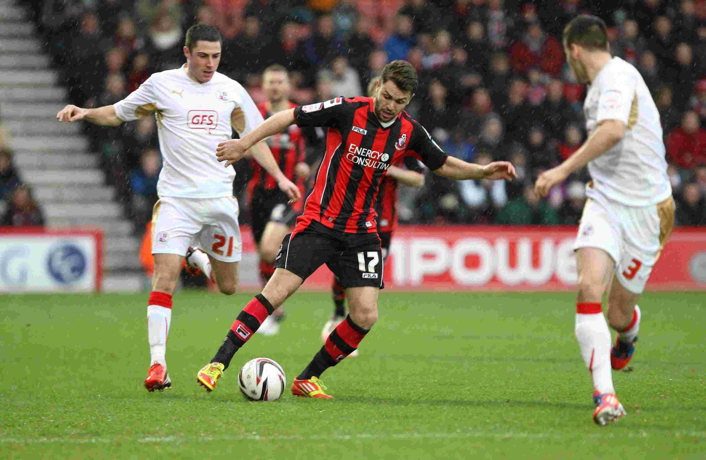 EXIT: Josh McQuoid in action for Cherries against Crawley in 2012