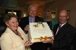 CELEBRATION: Bournemouth Literary Luncheon Club mark 60 years. Guest speaker, actor Colin Baker, with chairman Glenys Jenkins and Bournemouth's mayor Bob Chapman, right, and mayoress Barbara Johnson, with the special cake baked to mark the occasion