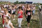 Race for Life in aid of Cancer Research UK at Canford Park Arena in Poole. Runners keep themselves hydrated in the heat.
