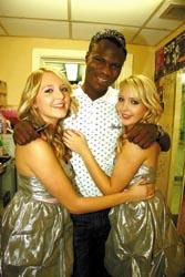 Bournemouth Echo:  Twin grip  Brian Belo gets close to twins Sam and Amanda Marchant at Jumpin Jaks