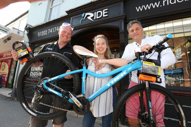 Nurse Rebekah Everett receives her replacement bike from Richard Hilton-Foster , owner of Ride in Ashley Cross and Adam Liddle from Adam Liddle Properties who has paid for the bike after Rebekah had her previous one stolen.