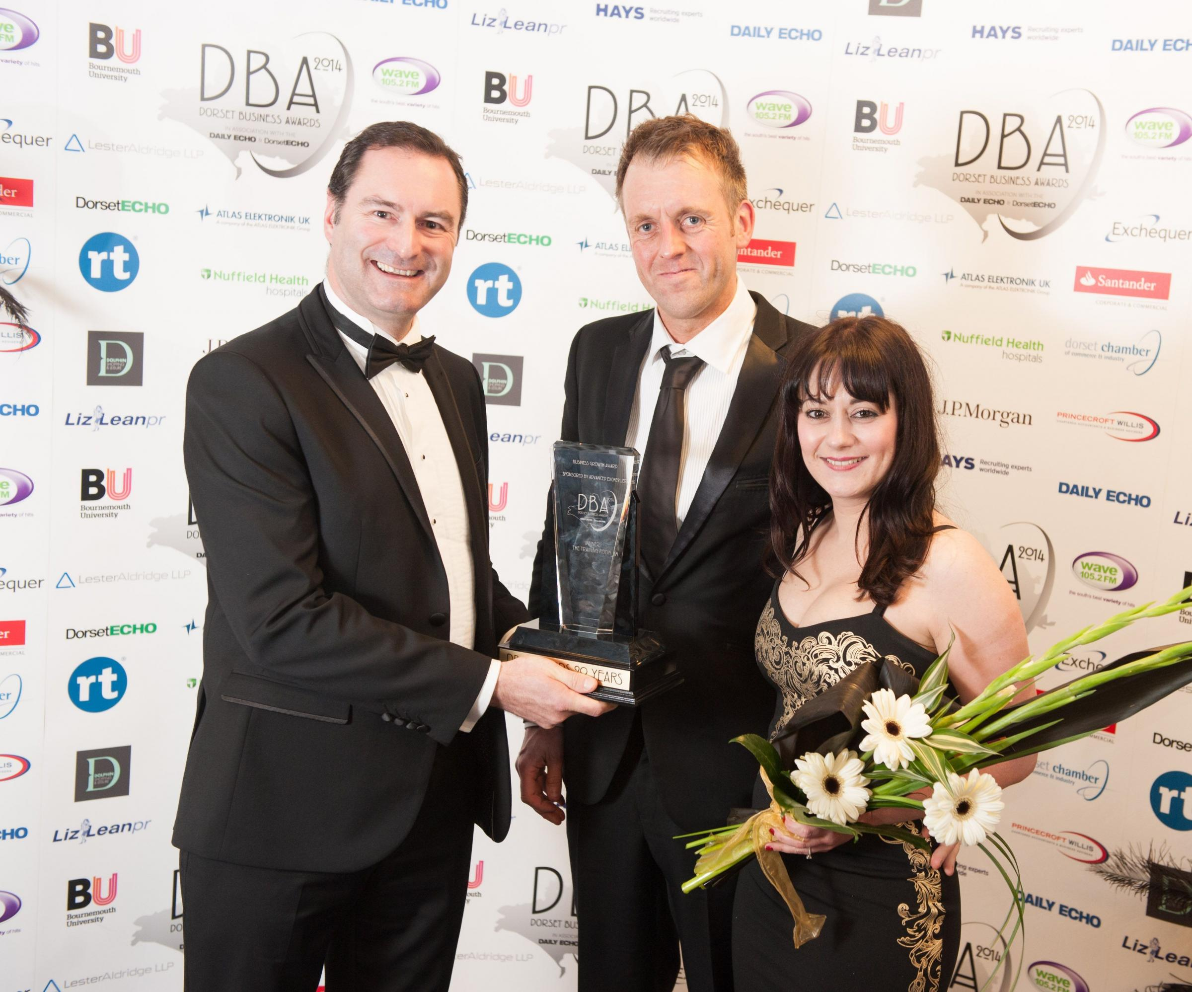 GROWING CONCERN: Greg Ford of Advanced Exchequer with Jonathan Davies and Hayley Evans of the Training Room, winner of the Business Growth Award at the 2015 Dorset Business Awards