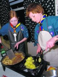 BANGERS WITH PANACHE: Two 1st Mosterton Scouts cook their mustardy sausages      Picture: GRAHAM HUNT/HG3330