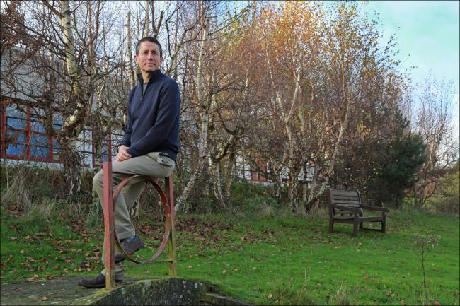Steve Blonstein in the Orchard Therapeutic Garden at Bournemouth Hospital which will be transformed following his donation through Dorset Cancer Care Foundation.