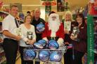 L to R: Tony Dack – Sainsbury's deputy store manager, Anne Simpson – Poole Tourism events manager, Rod Brown – Poole Lifeboat operations manager, RNLI, Father Christmas, Kirsty Perks – Sainsbury's and Jo Crabb – Sainsbury's.
