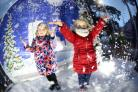 Molly Pike, 3, and Phoebe Pike, 5, enjoy the snow