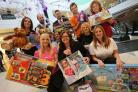 APPEAL: Dolphin Shopping Centre retail liaison manager Lisa King with retailers who donated gifts to the Daily Echo Toy Appeal last year
