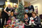 XMAS JOY: NatWest Area Manager Mike Lomer, back right, with staff at the Castlepoint branch and some of the toys donated to the Echo Toy Appeal
